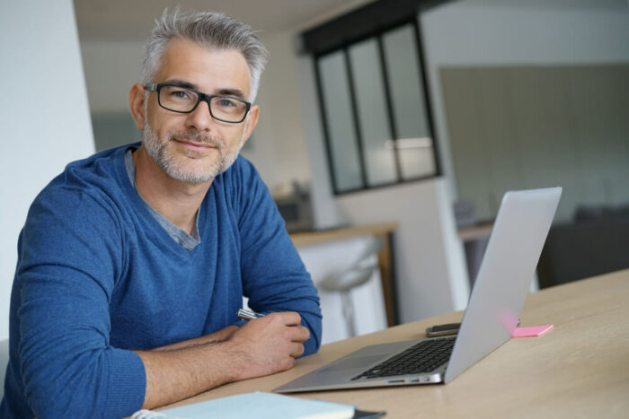 Middle age man at laptop