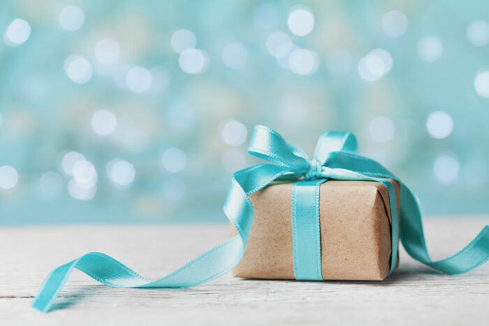 blue and kraft paper wrapped present